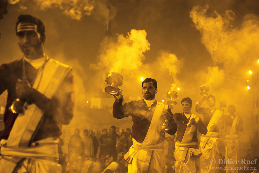 India. Uttar Pradesh state. Allahabad. Maha Kumbh Mela. Ganga Aarti ceremony at night. Ganga Aarti (also spelled arathi, aarthi) is a Hindu religious ritual of worship, a part of puja, in which light from wicks soaked in ghee (purified butter) or camphor is offered to one or more deities. The Kumbh Mela, believed to be the largest religious gathering is held every 12 years on the banks of the 'Sangam'- the confluence of the holy rivers Ganga, Yamuna and the mythical Saraswati. The Maha (great) Kumbh Mela, which comes after 12 Purna Kumbh Mela, or 144 years, is always held at Allahabad. Uttar Pradesh (abbreviated U.P.) is a state located in northern India. 11.02.13 © ۲۰۱۳ Didier Ruef *** Local Caption ***